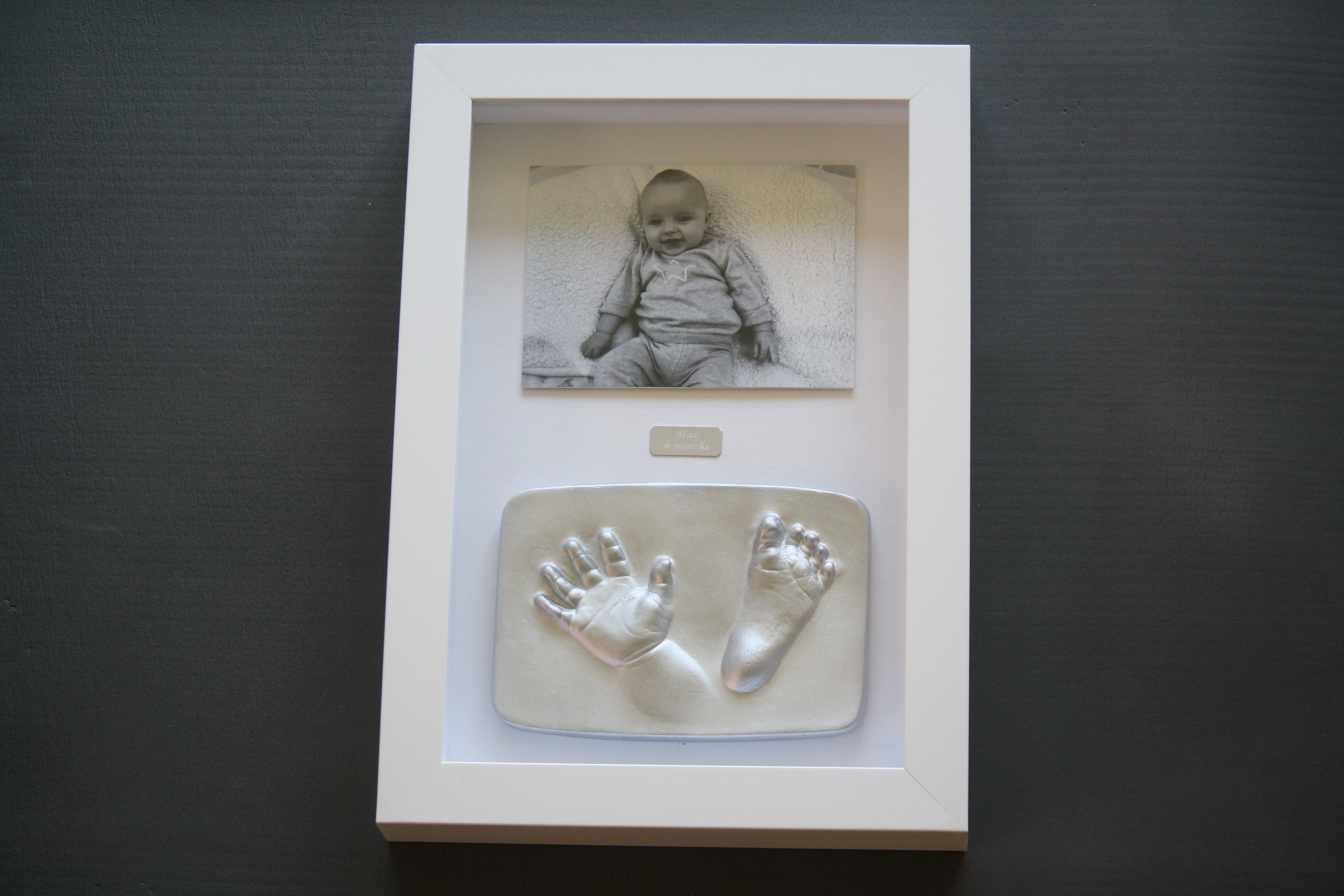 2d hand and foot impression tile in nursery frame with photo