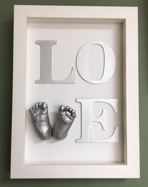 Love sign frame 3d baby feet casts create a V