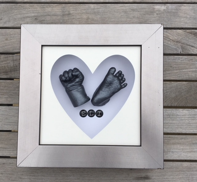 silver frame with heart shape mount with 3d baby hand and foot c