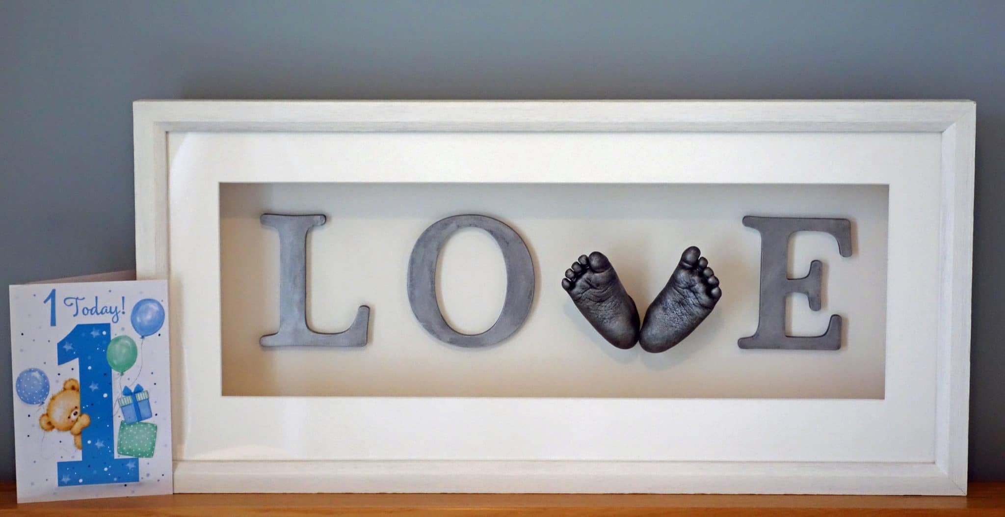 Framed 3D baby feet in love sign frame