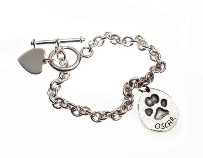 silver dog paw print charm of cockapoo on tiffany bracelet