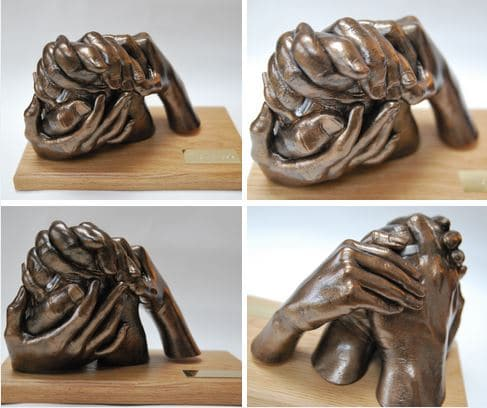 3D free-standing family hand casting on wooden plinth and plaque