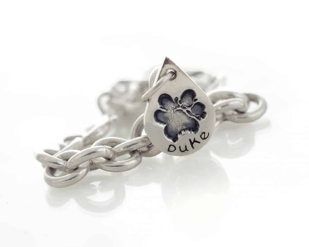 loss of a beloved pet pawprint silver charm on tiffany style bracelet