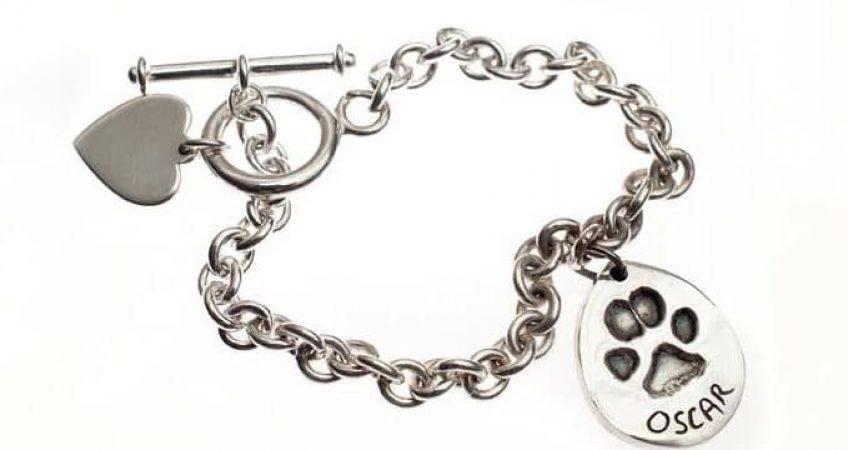 silver dog paw print charm of cockapoo on tiffany bracelet